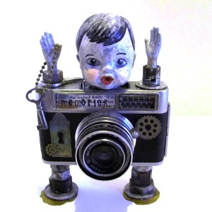 Camera assemblage doll featured in Somerset Studio Gallery